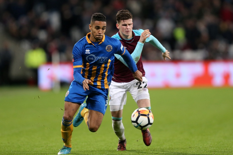 Max Lowe of Shrewsbury Town competes with Sam Byram of West Ham United.